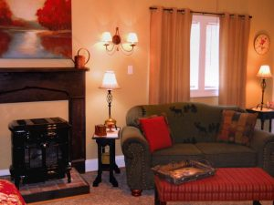 Rosebud Cottage fireplace in living room with cathedral ceilings.
